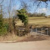 Stile giving access to the Malpas end of Lodge Hill walk