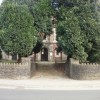 Trees partially shielding Coptic Orthodox Church, Risca