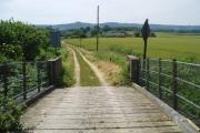 The railway bridge leading to Spooner's Farm
