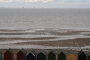Beach huts and incoming tide, Herne Bay
