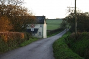 House with bridge over disused railway near Rawstone Moors