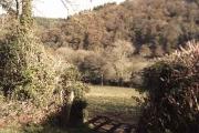 Farmland: the shadow of a gate.
