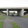 The A66(M) crosses an unclassified road near Stapleton.