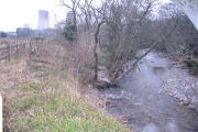 The river Calder with Calder Hall cooling towers.