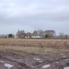 Looking across farmland to old thatched farmhouse
