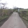 Old iron bridge over the R. Axe at Wadbrook