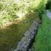 Fallen riverbank wall on river Clydach