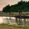 Narrow boat on the river Nene at dusk, Peterborough