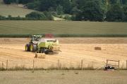 Broadclyst: baling straw near Killerton Park