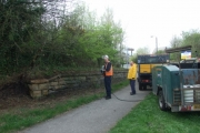 Steam cleaning the old stone bridge in Langley Park